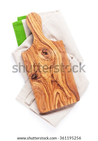 Cutting board over towel. Top view. Isolated on white background - stock photo