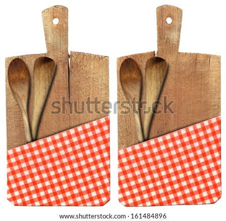 Cutting Board with Ladles and Tablecloth / Used chopping or cutting board isolated on white with red checked tablecloth and two wooden spoons or ladles   - stock photo
