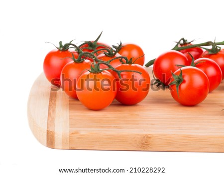 Cutting board with tomatoes-cherry. Close up on a Whole background. - stock photo