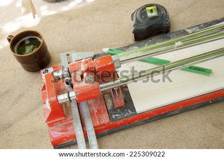 cutting ceramic tiles with a tile cutter  - stock photo