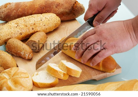 Cutting different sort of bread with knife