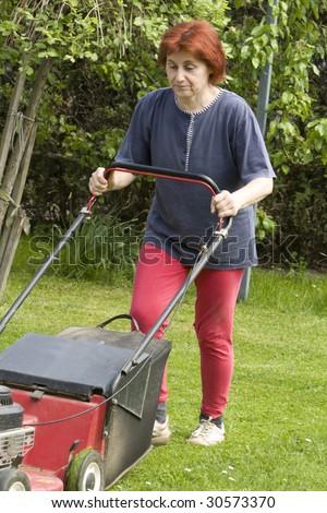 cutting grass - stock photo