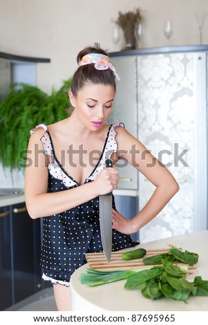 Cutting greens in the kitchen - stock photo