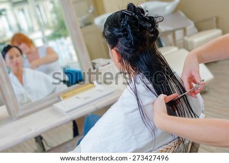 Cutting long hair - stock photo