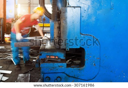 cutting machine for metal sheets in mechanical workshop - stock photo