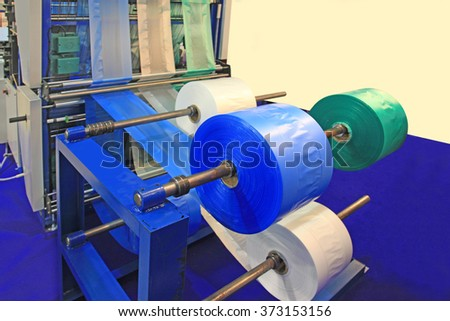 Cutting machine for polyethylene bags six lines - stock photo