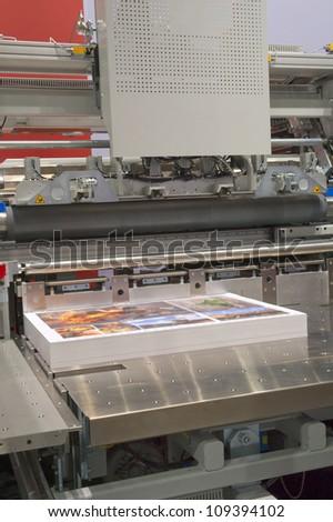 Cutting machine in a print shop - stock photo