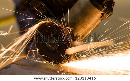 cutting metal by electric wheel grinding