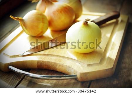 Cutting onions. - stock photo