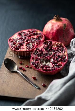 Cutting Pomegranate fruit - stock photo