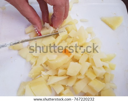 cutting potatoes into pieces to prepare food