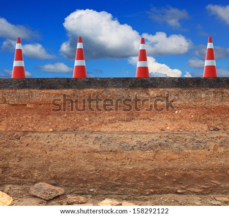cutting surface of asphalt road inner structure scouring by water flood attack indicated layer of road structure and road making process - stock photo