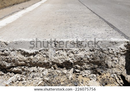 Cutting surface of concrete road under construction - stock photo
