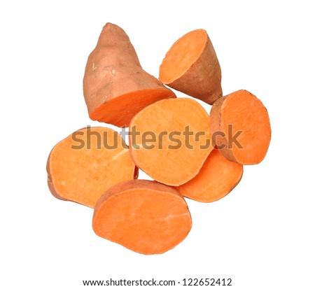 cutting sweet potatoes isolated on white background - stock photo