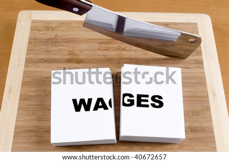 Cutting wages with a cleaver and cutting board. - stock photo