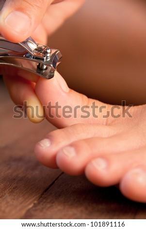 Cutting your toenails - stock photo