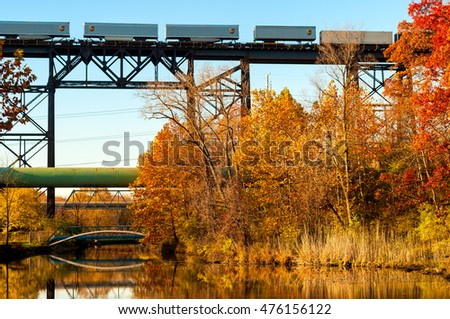 CUYAHOGA HEIGHTS, OH - NOVEMBER 2, 2015: A UPS freight train crosses a high trestle above the Ohio Canal a few miles south of Cleveland in late autumn.