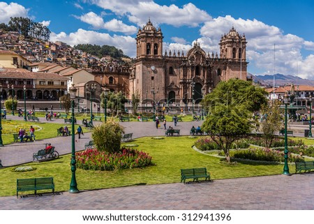 Cuzco, Peru: Panoramic view of the  Main square an the cathedral church. - stock photo