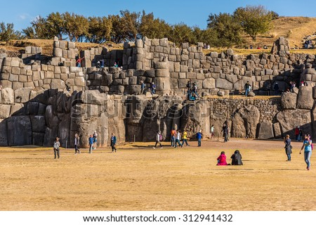 Cuzco, Peru: People in Sacsayhuaman. - stock photo