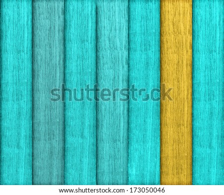 Cyan and orange colored wood plank background close up - stock photo