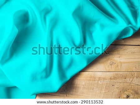 cyan fabric texture on wood background