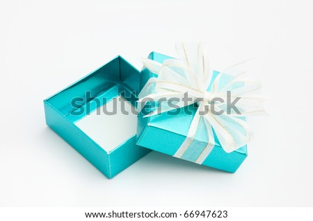 cyan gift box is opened on white background