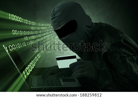 Cyber crime concept: Anonymous man stealing credit card numbers - stock photo