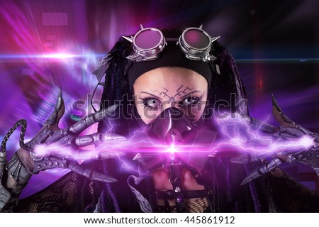 Cyber Gothic girl with rays of light in a dark background - stock photo