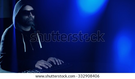 Cyber hacker hacking network blue lights - stock photo