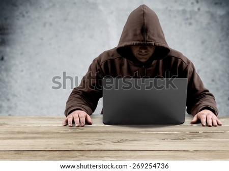 Cyber. Hacker waiting for something with binary code in background - stock photo