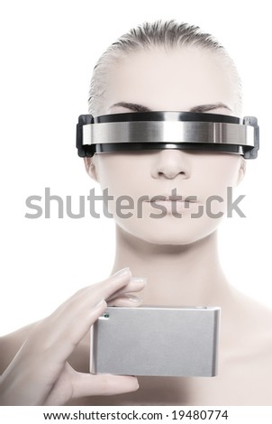 Cyber woman holding silver gadget - stock photo