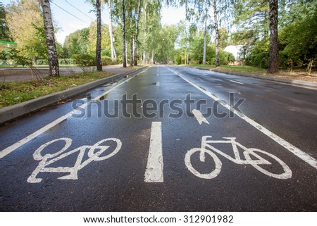 cycle way in a park - stock photo