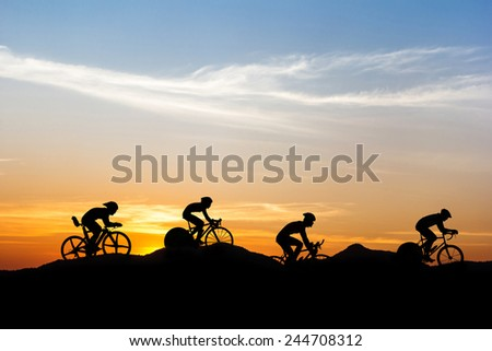 Cycling at mountain on twilight time - stock photo