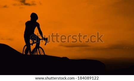 Cycling on mountain twilight time - stock photo