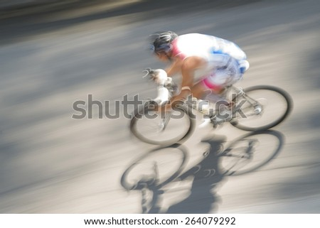 Cycling race with representation runner with blur - stock photo