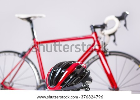 Cycling Safety Concept. Road Bike Protection Helmet in Front of Professional Road Bike. Horizontal Image Composition - stock photo