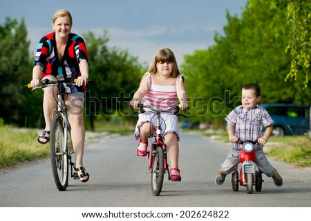 cycling with family/cycling with family - stock photo
