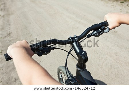 cycling with the speed. Focus on the handlebars. - stock photo