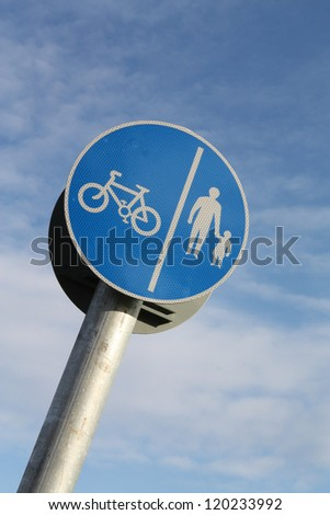 Cyclist and pedestrian route sharing sign. - stock photo