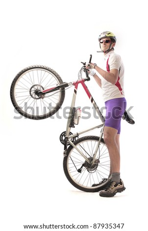 Cyclist carrying a mountain bike - stock photo