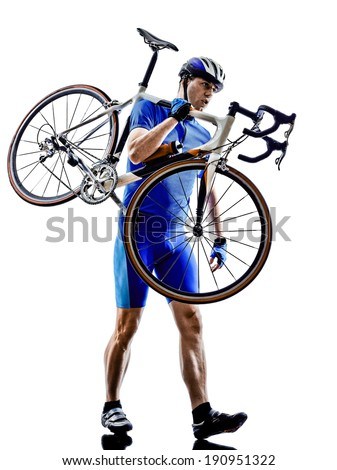 cyclist carrying bicycle  in silhouettes on white background