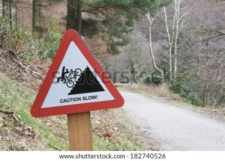 Cyclist Caution, steep slope and slow down warning sign on a countryside track - stock photo