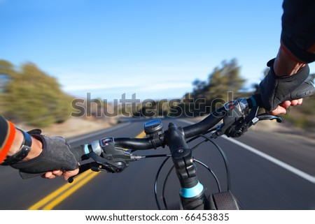 Cyclist in motion, selective focus. - stock photo