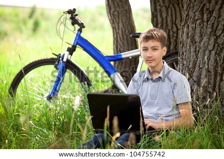 cyclist in park with laptop