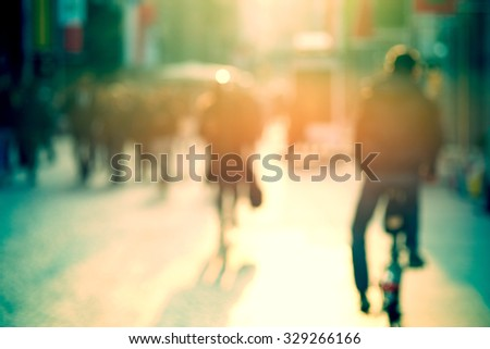 cyclist in the street, blurry - stock photo