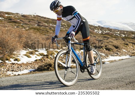 Cyclist man riding mountain bike on a mountain road
