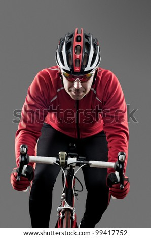 Cyclist on road bike on grey background. - stock photo