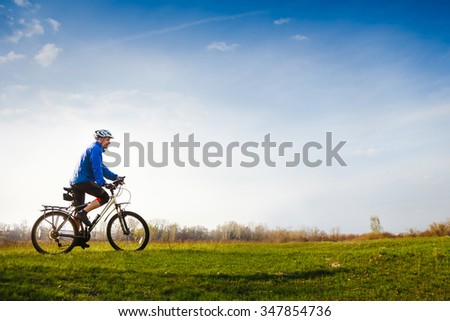Cyclist on the Beautiful Meadow Trail on sunny day