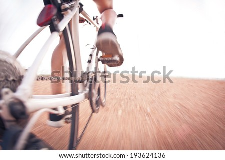Cyclist riding  bike on  trail - stock photo