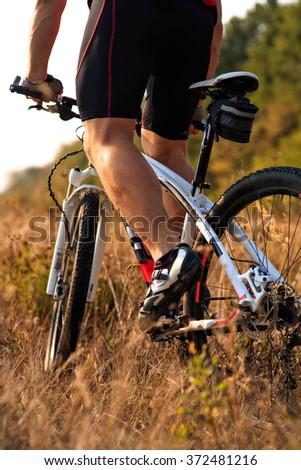 cyclist riding mountain bike on rocky trail - stock photo
